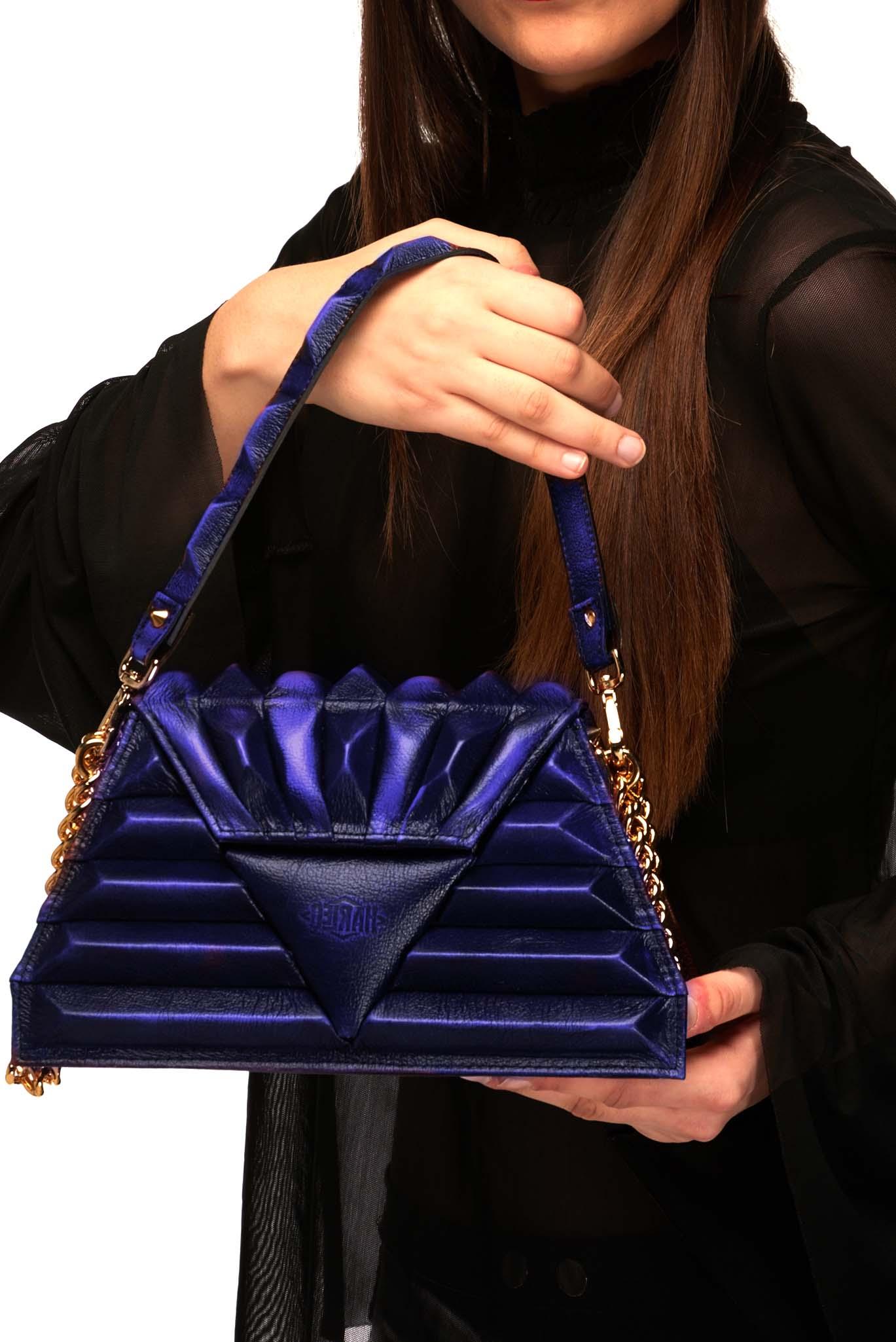 Harleq spinx pochette blue leather