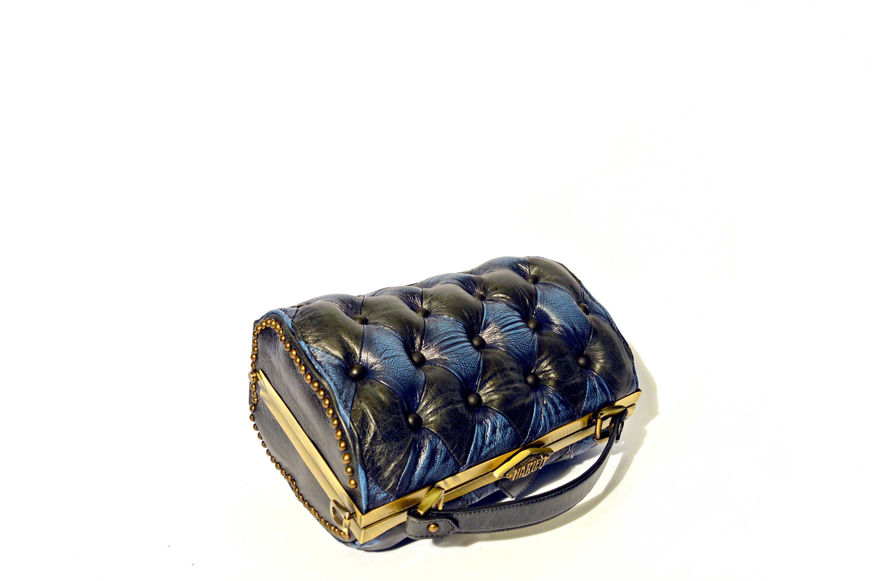 black blue leather handbag