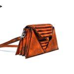 harleq luxury handbag orange leather triangles