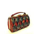 red black leather bag side